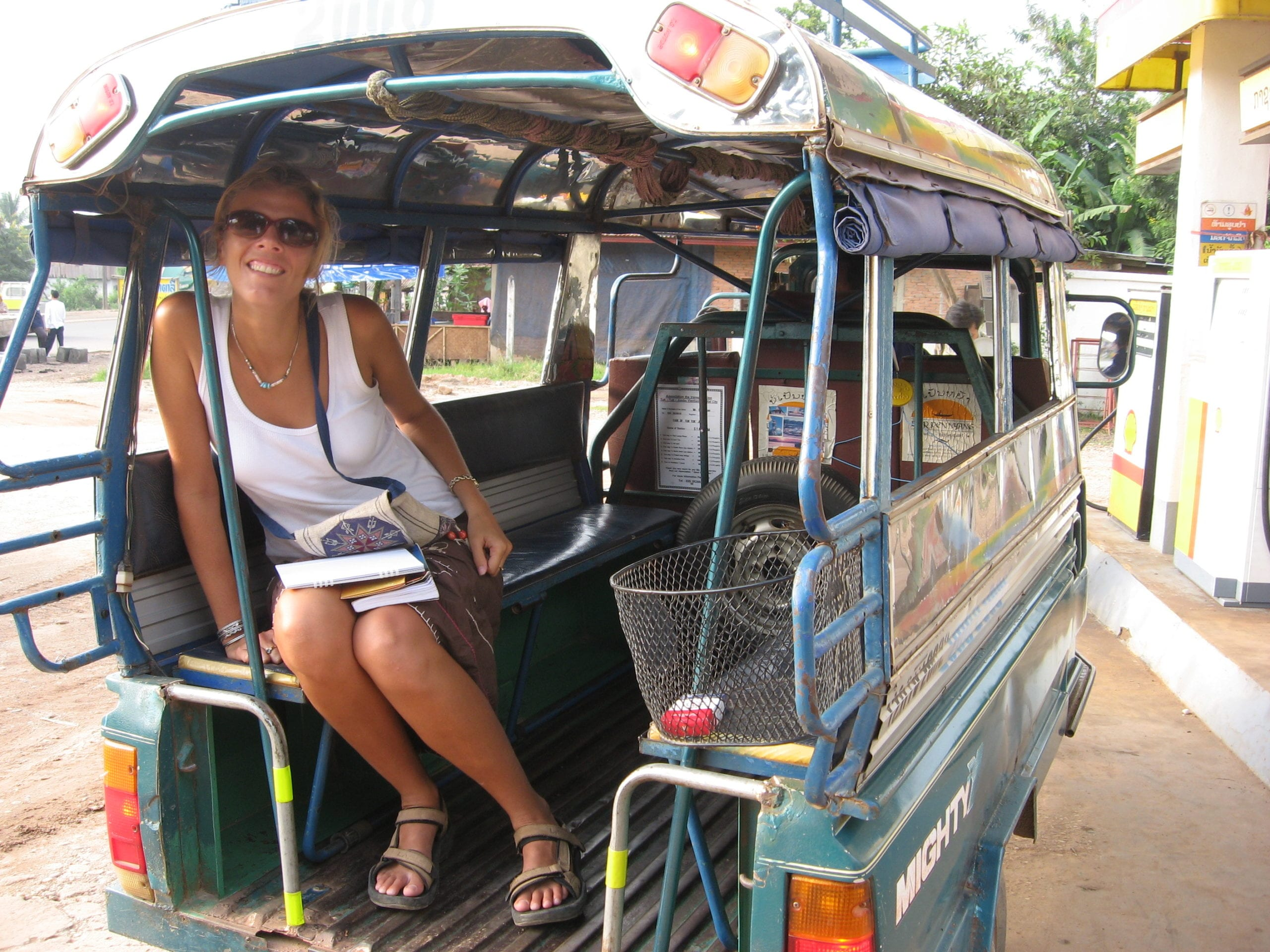 riding a tuk tuk in Laos is cheap!