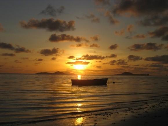Sunset over Cousine Island from Praslin beach