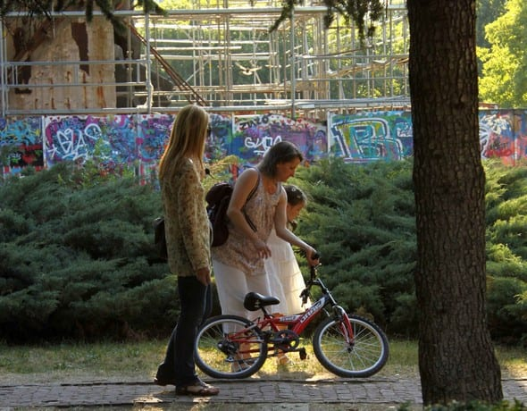 Mother teaching her daughter to ride bike