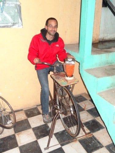 Riding a bike blending machine while volunteering at Maya Pedal