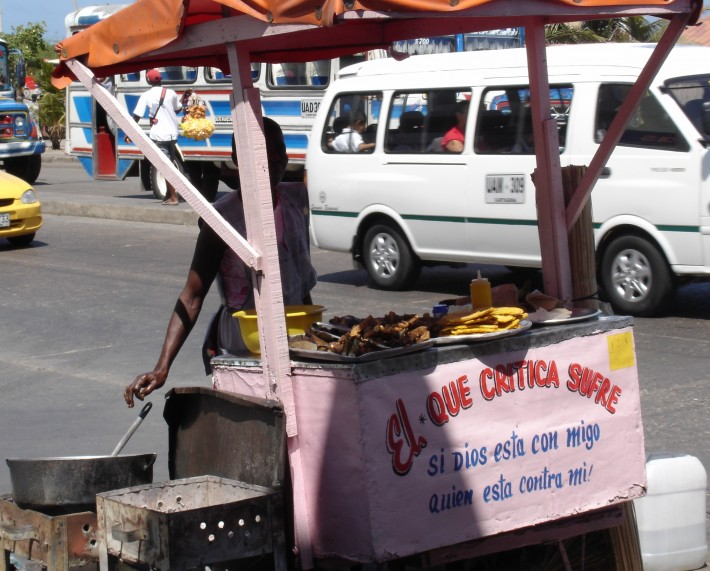 A food stall serving fried meat and plantain.