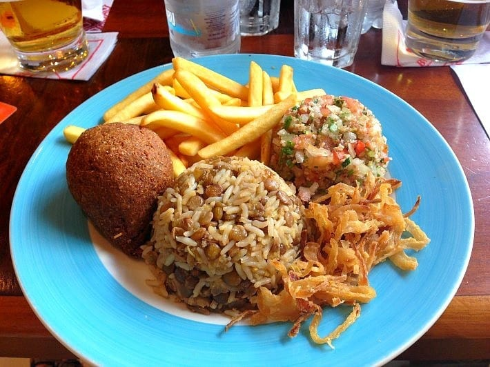 A fried cheese ball, rice and lentils and tabbouleh from Beduino.