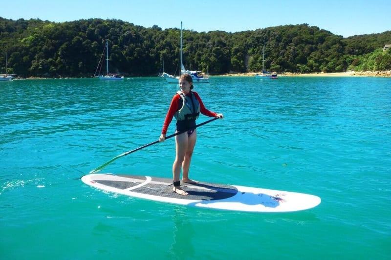 Lauren paddleboarding in Abel Tasman, New Zealand