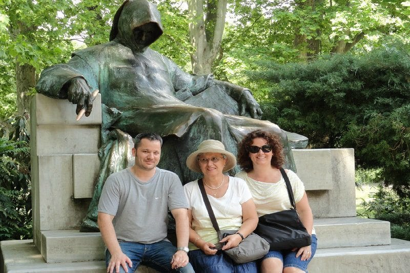 Amanda (right) with her brother and mum at the famous statue of 'Anonymous' – the unidentified author who first detailed the history of the Hungarians in the 12th century.