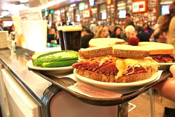 Eat a Rueben sandwich at Katz's Deli - One of the iconic places to Eat in NYC