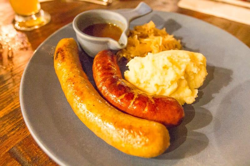 a plate of wurst - kransky and brat with mash and sauerkraut. at Heisenberg Haus in Ipswich, Queensland