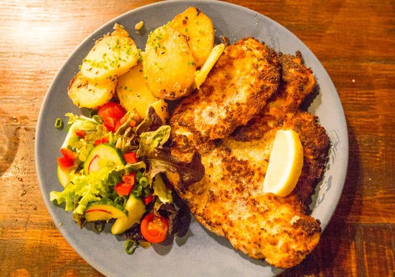 Ginormous chicken schnitzel with pan-fried potatoes at Heisenberg Haus in Ipswich, Queensland