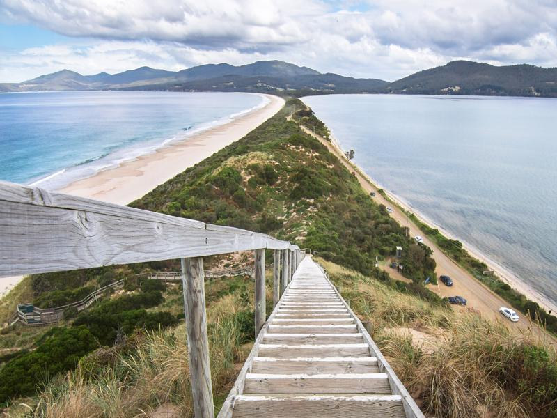 The Neck Lookout Looking down a staircase at a very narrow isthmus with a road along it on Bruny Island, Tasmania.