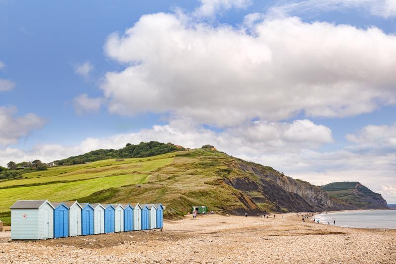 30 June 2017: Charmouth, Dorset, England, UK - The beach in summer, popular with fossil hunters