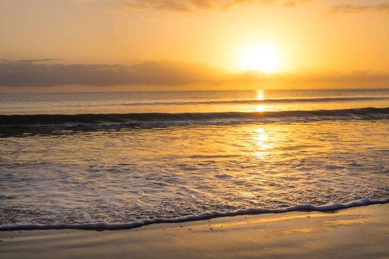 Sunrise over Cape Tribulation Beach in the Daintree Rainforest of Queensland, Australia