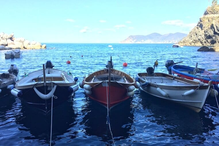 Go on a boat tour - one of the best things to do in Cinque Teere, Italy