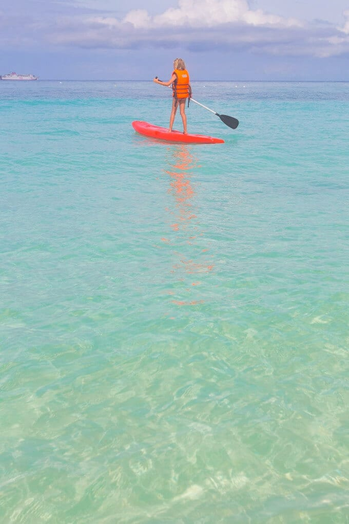 Punta Bunga Beach on Boracay in the Philippines is a great place to go stand up paddle boarding with kids!