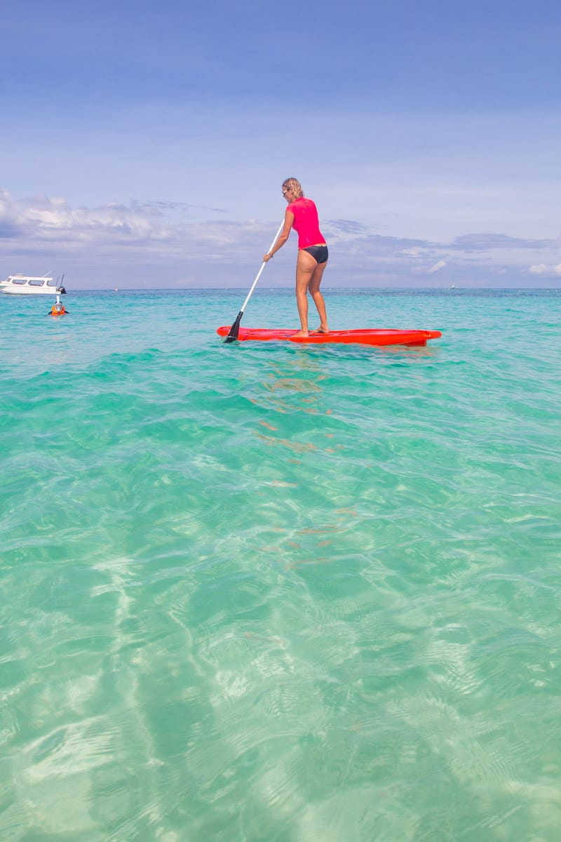 Stand up paddle boarding on Punta Bunga Beach on Boracy Island, Philippines