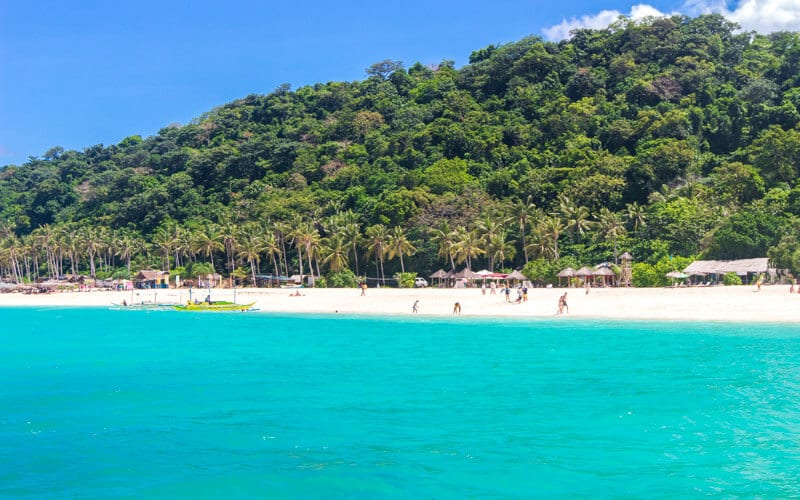 Puka Beach is one of the best beaches to visit with kids on Boracay Island The Philippines