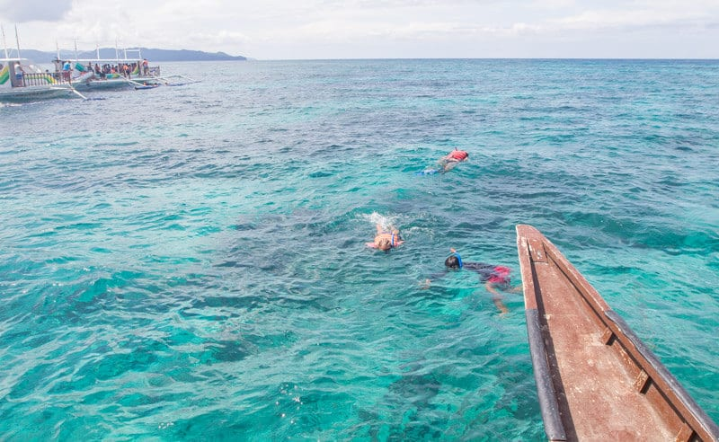Snorkeling at Balinghai Beach Boracay is one of the best things to do in Boracay Island the Philippines. Click to read more travel tips for Boracay with kids