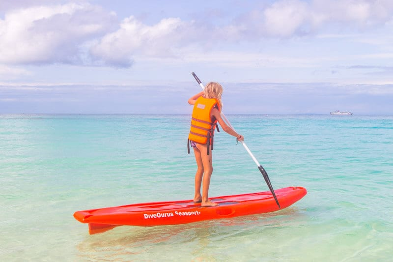 STand up paddle boarding on Punta Bunga Beach Boracay Island is one of the best things to do in Boracay with kids. Click to read more tips for this Philippines Island