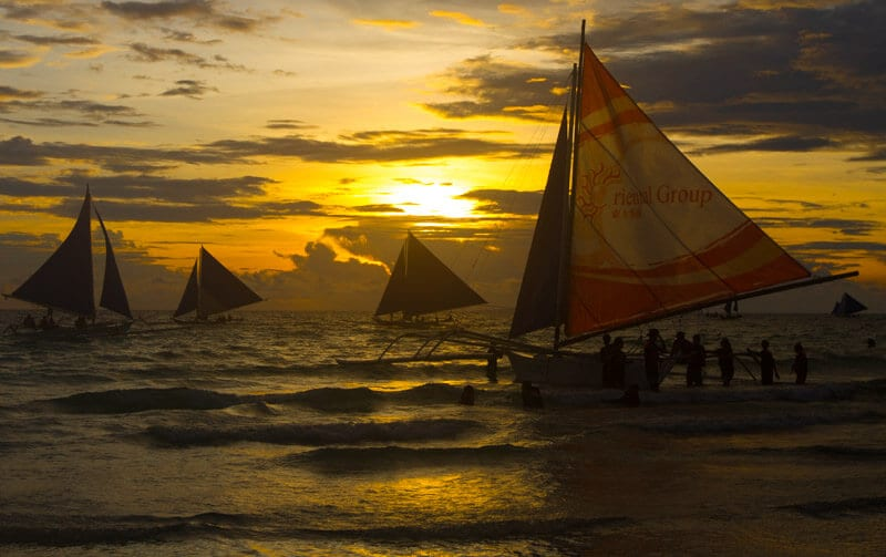 White Beach Boracay Island is one of the best beaches in the Philippines. Sunsets are beautiful in Boracay. Click to read tips on things to do in Boracay with kids
