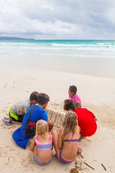 White Beach Boracay Island is one of the best beaches in the Philippines. Sand sculpting is very popular Click to read tips on things to do in Boracay with kids.