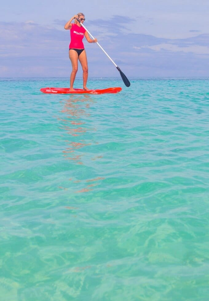 Punta Bunga Beach on Boracay in the Philippines is a great place to go stand up paddle boarding with kids