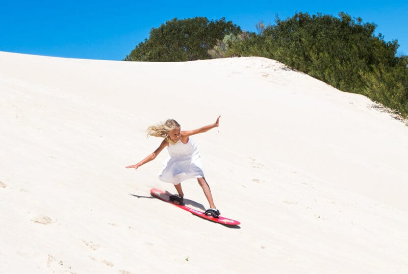 Sandboarding the Little Sahara sand dunes is a highlight of a road trip to Kangaroo Island in South Australia