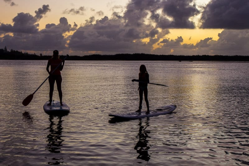 Sunrise stand up paddle boarding in Caloundra on the Sunshine Coast of Queensland, Australia