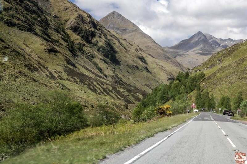 Between Glencoe and the Isle of Skye, the main road takes you through Glen Shiel. There the road winds through the valley, following River Shiel and nested between towering mountains.