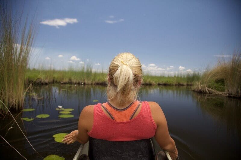 Taking a ride in a mokoro is the perfect way to experience the Okavango Delta and is one of the best things to do in Botswana