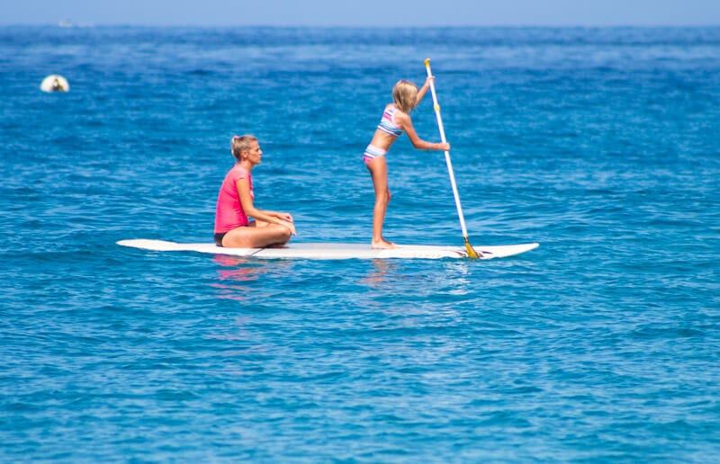 Stand up paddle boarding at Kaanapali Beach on the island of Maui in Hawaii