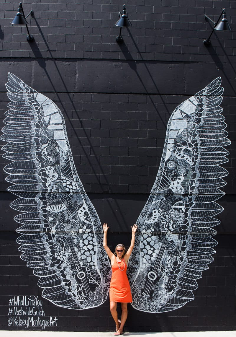 Don't miss getting your photo taken in front of the Lift Your Wings mural in the Gulch neighborhood of Nashville, Tennessee