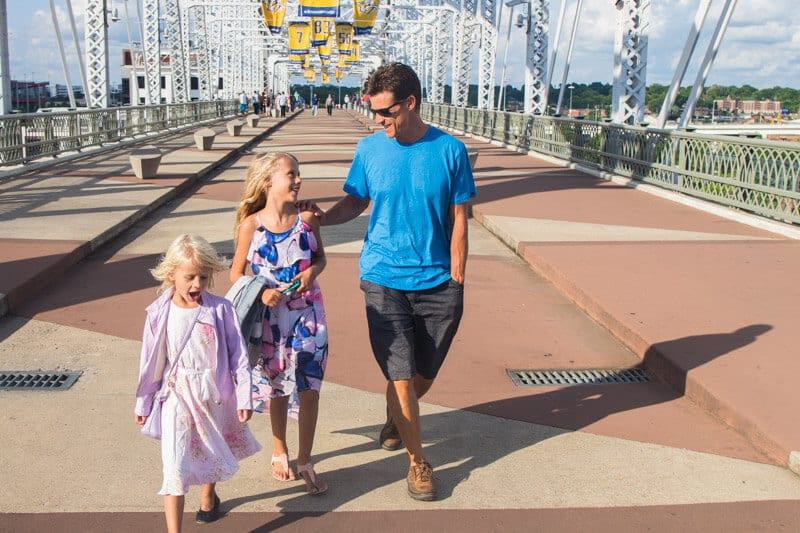 Walking across the pedestrian bridge in Nashville