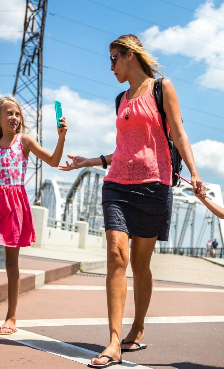 Walking across the pedestrian bridge in Nashville