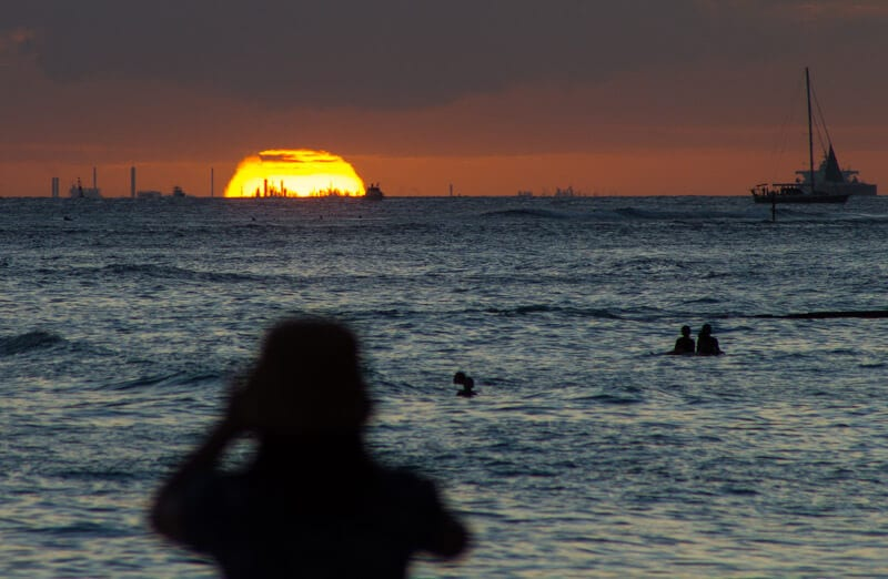 Sunset over Waikiki Beach -one of the top free things to do in Oahu with kids