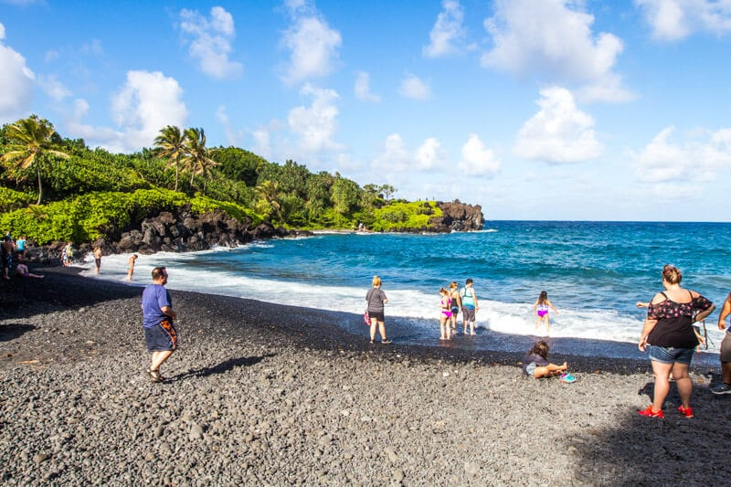 black sand beach named Pai'iloa Beach, one of the best stops along the Road to Hana drive in Maui, Hawaii