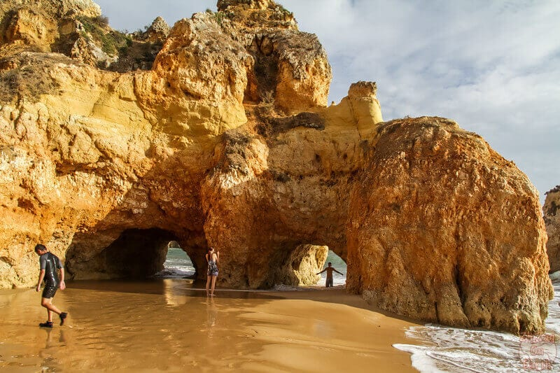Algarve's Praia dos Tres Irmaos beach is best explored at low tide