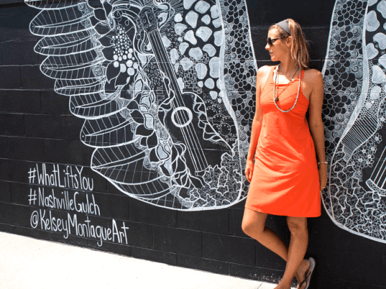 Caz loves her Barton Dress because it's light and comfortable, and she can wear it casually or when going out. It comes in two colors, coal or koi (Caz's choice) and it features a recycled poly fabric with an interior shelf bra.