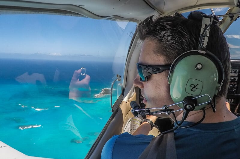 Flying and Travel Bahamas Island hopping tour by plane. Flying to Bahamas from Florida with Bahamas Air Tours. For the best Bahamas Day Trip from Miami to visit the Exuma Pigs, Staniel Cay, Harbour ISland Bahamas and Eleuthera Island.