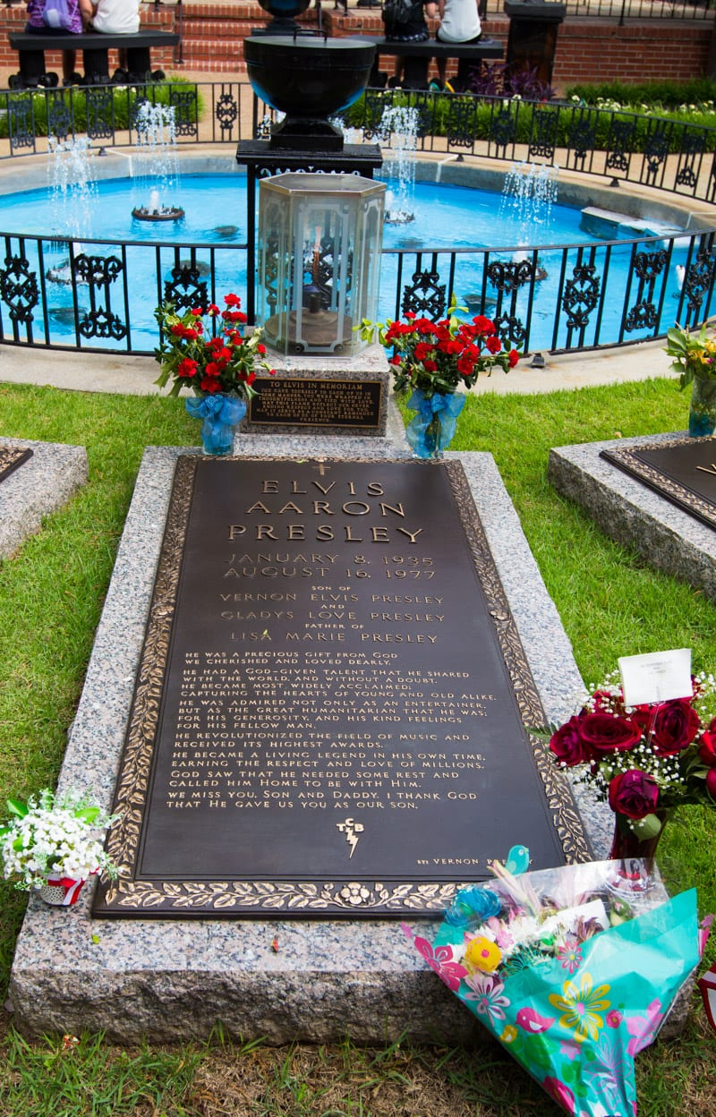 Elvis Presley grave at Graceland, Memphis, Tennessee. Take a tour of his former home! See inside for more info.