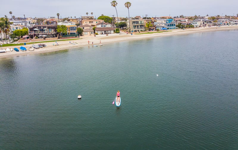 Stand up paddle boarding in Mission Bay - - one of the best things to do in San Diego with kids!