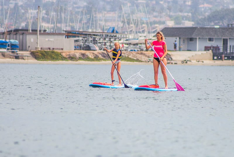 Stand up paddle boarding on Mission Bay - one of the best things to do in San Diego with kids!