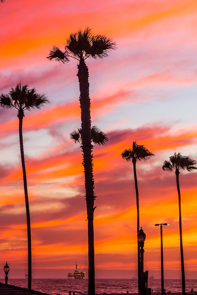 Sunset in Huntington Beach, California. One of the best free things to do in Orange County