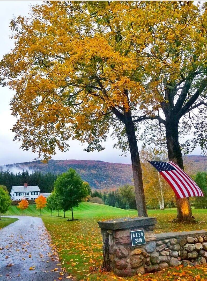 New England fall foliage in Vermont. Get tips inside for doing a New England road trip in the fall