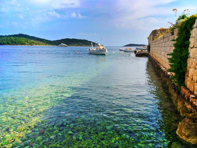 Colorful water at city wall Port of Vis Croatia 1