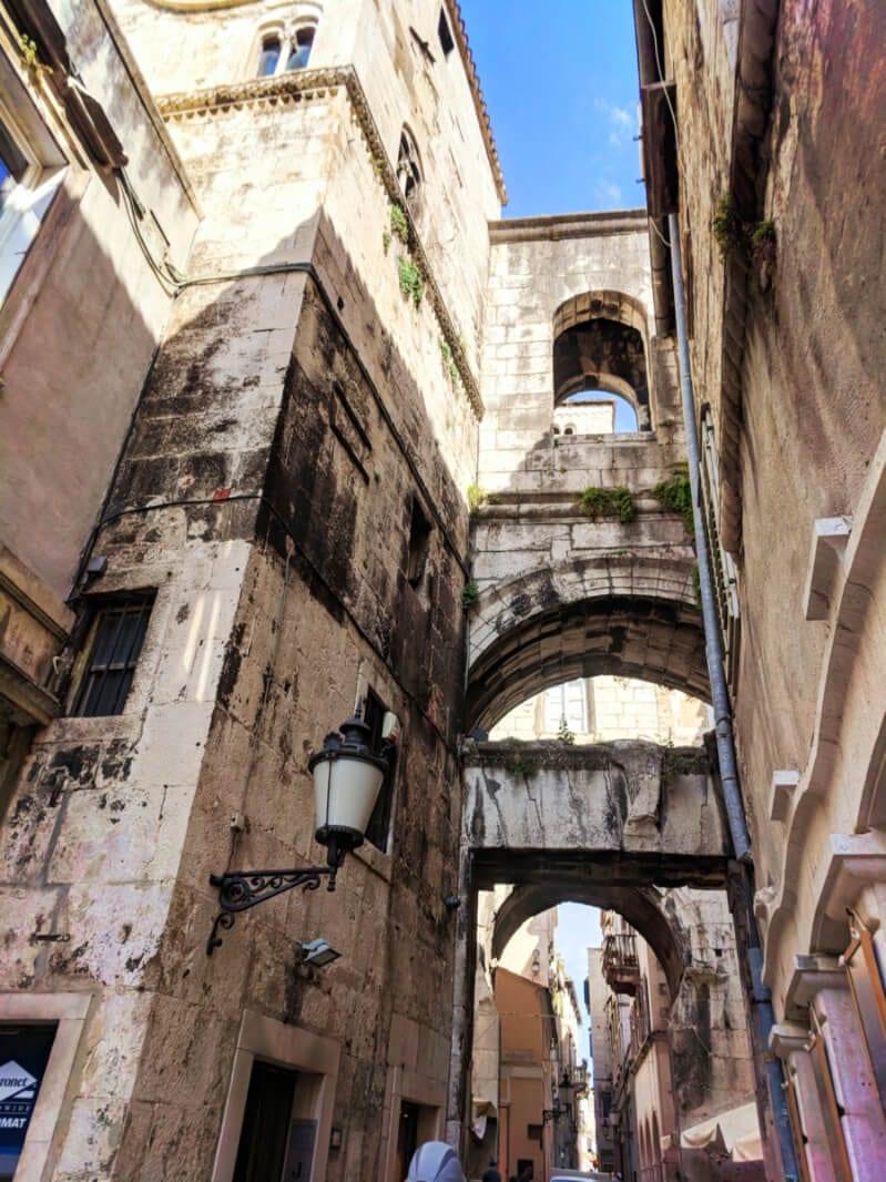 Narrow ancient bridges over passageways in Old Town Split Croatia