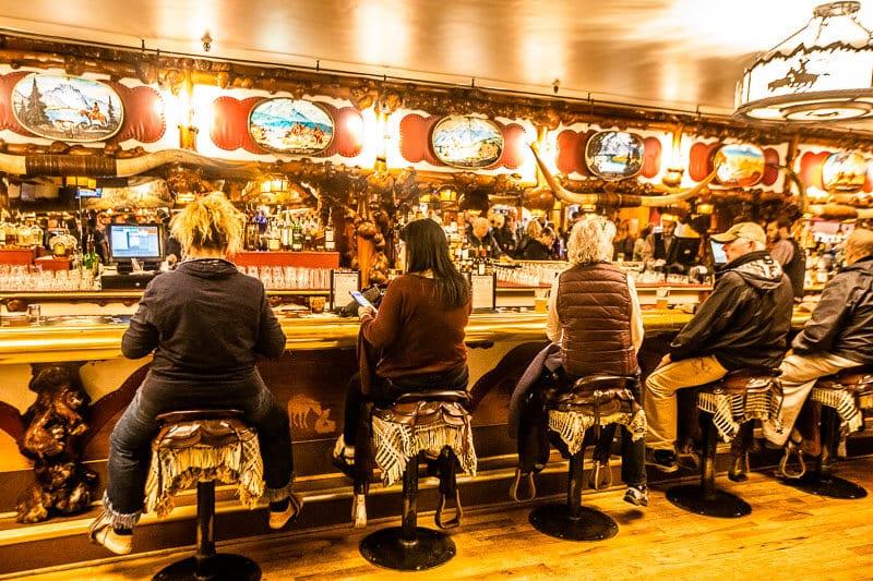 Saddles for seat at Million Dollar Cowboy Bar in Jackson