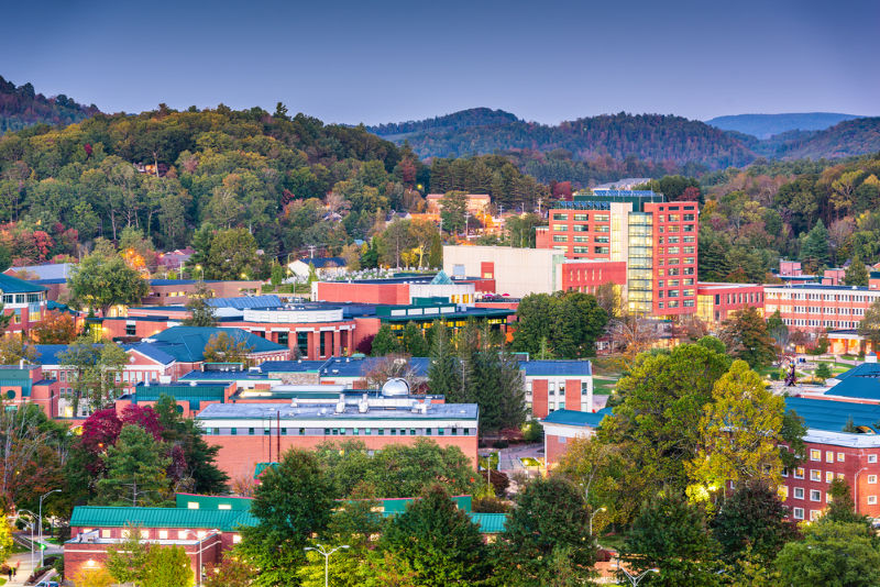 Boone, North Carolina, USA campus and town skyline at twilight.