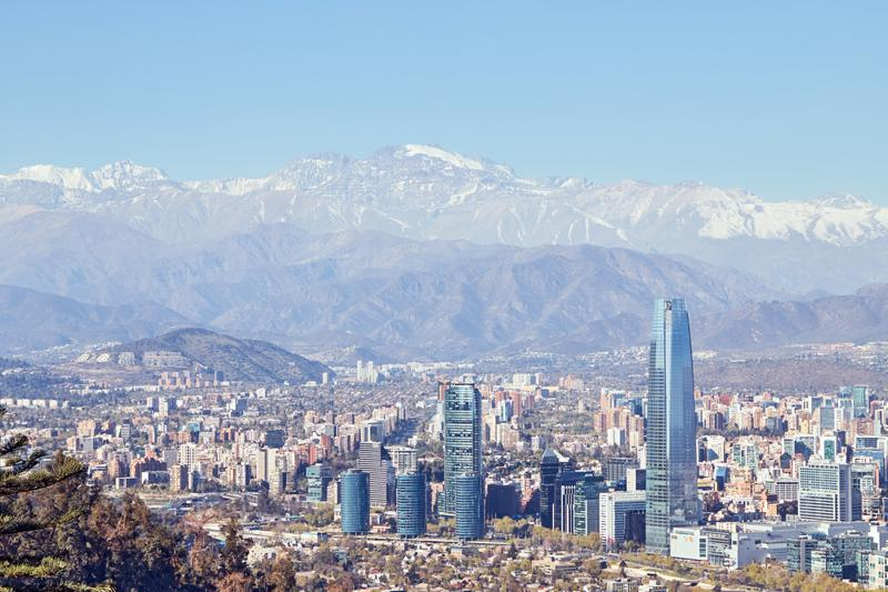 Daytime view of Providencia, Santiago de Chile with Los Andes mountain range in the back.