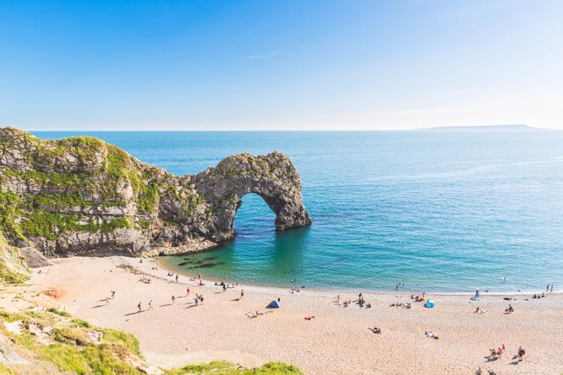 Pranoramic view of Durdle Door and seaside. Famous rock arch in the Jurassic coast, Dorset, England.
