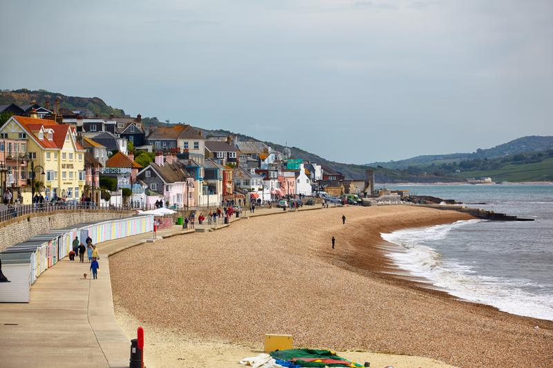 he view of the Lyme Regis Marine Parade – a promenade along the Lyme bay, a part of South West Coast Path. West Dorset. England