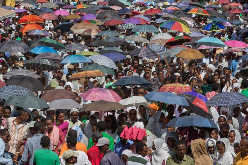 A large crowd of people with colorful umbrella accompany the Tabot, a model of the arc of covenant, during a colorful procession which is part of Timket celebrations of Epiphany, commemorating the baptism of Jesus in the river of Jordan