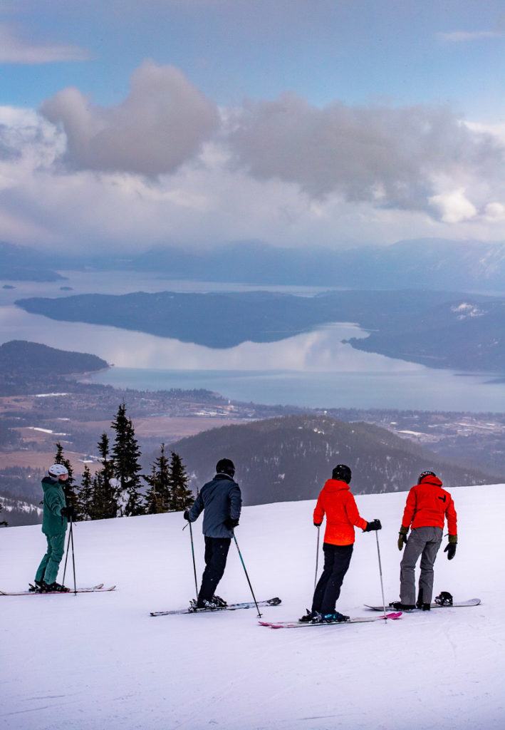 Skiers about to take on a Black run at Schweitzer
